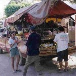 Here's Bonnie using her Spanish buying fruit from street vendors in front of her house in Mexico.